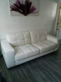 Leather white contemporary sofa and chair.