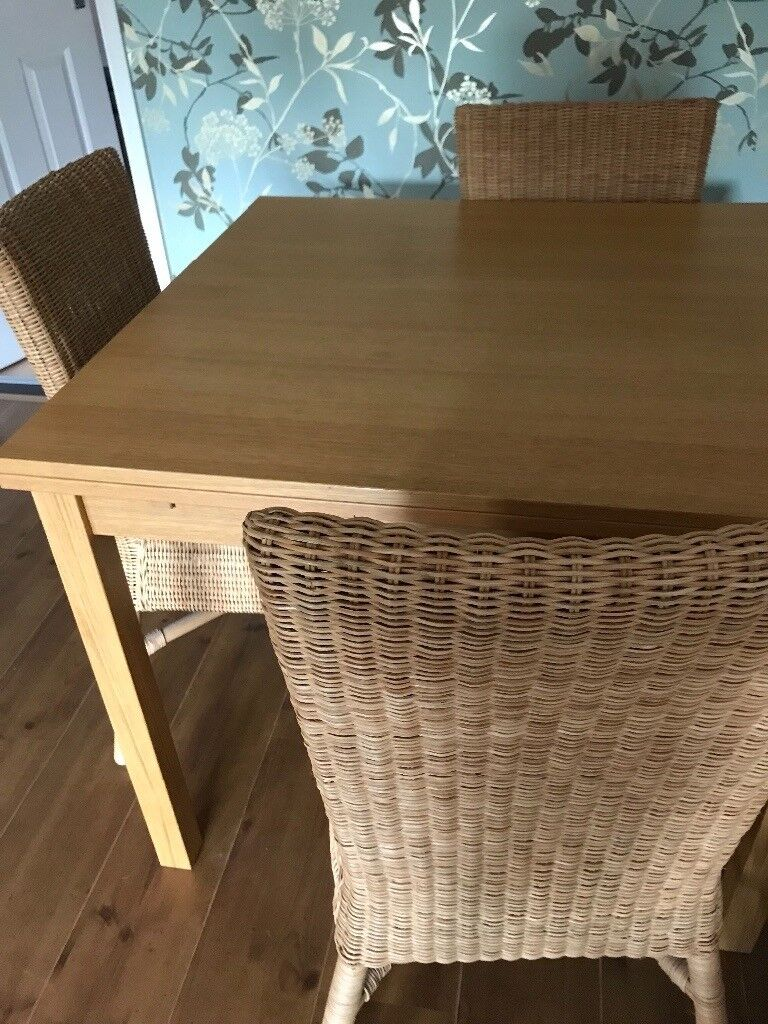 Oak dining table and 4 rattan chairs