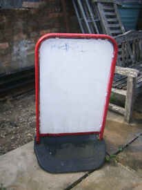 Double sided advertising board