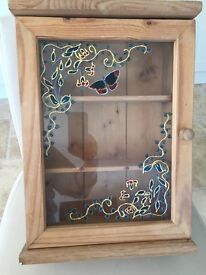 Small pine cabinet with glass patterned door