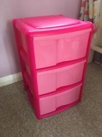 Set of 3 pink plastic drawers.