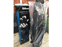 Brand New Golf Clubs for sale. Wilson Reflex Woods, Irons, putter and Stand Bag wrapped and boxed.