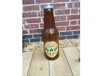 Large Newcastle brown ale coin saver - 22 inches tall
