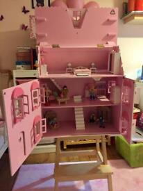 Large wooden dolls house with accessories.