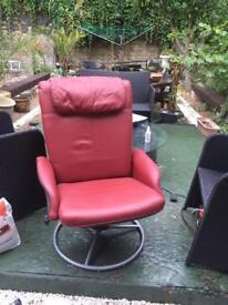 Red leather reclining chair with chrome metal swivel stand
