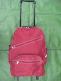 Dark Pink Fabric Cabin-Size Suitcase with Telescopic Handle and Wheels for £8.00