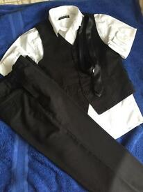 Boys tie shirt and waistcoat and trousers