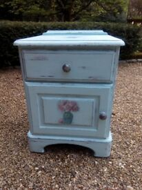 A hand painted distressed shabby chic style decoupage bedside table.