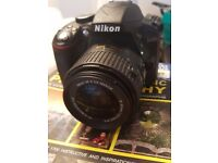 -New Nikon 3300 with 18-55 mm lens.