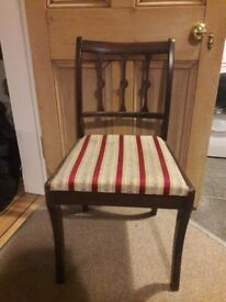 Wooden chair with padded seat