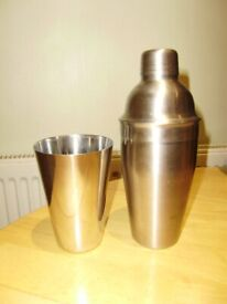 Cocktail shaker and a glass, both stainless steel, VGC
