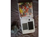 White nintendo 2ds with super smash bros