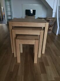Solid pine nest of three tables, the middle size has some marks.