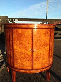 Curved wooden cabinet