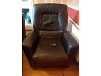 Brown leather electric recliner.