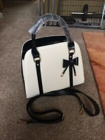 Black and cream handbag