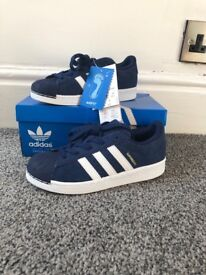Adidas Superstars size 2, navy and white. Brand new, never been worn.