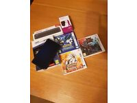 Metallic Blue Nintendo 3DS XL (Newer version) with 3 top games, charger and docking port