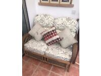 Cane 2 seater and 2 chairs with cushions