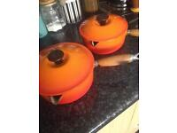 Le Creuset flame orange saucepans