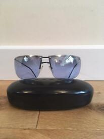 Beautiful genuine Gucci sunglasses with original case. Lenses have a blue tint.