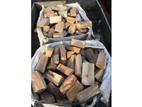 Seasoned hardwood firewood free delivery.