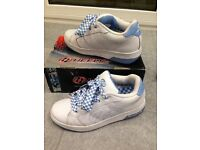 Heelys UK size 5/6 or 39 EUR. White with blue trim. In good condition in original box.