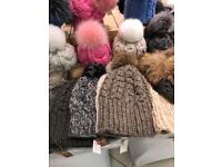 Women's fur-trimmer down-filled hooded puffer coats and handmade hats with fur pom poms hats