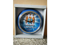 "MANCHESTER CITY F.C"" Football Quartz clock. New and supplied with battery."