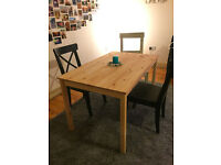Simple solid pine dining table