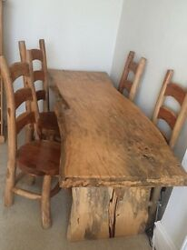 Beautiful wooden dining room table and chairs