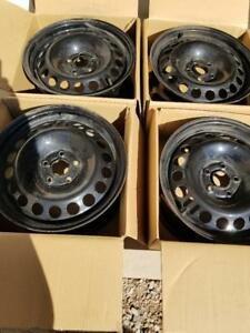 BRAND NEW TAKE OFF FACTORY OEM 2017 CHEVY CRUZE  16 INCH STEEL  WHEEL SET OF FOUR.