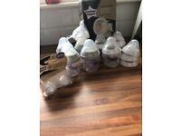 Baby bottles tommee tippee bottles, unused manual breast pump, mam steriliser, etc