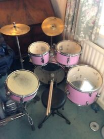 Used pink kids drum kit 4 peice set stool and sticks included