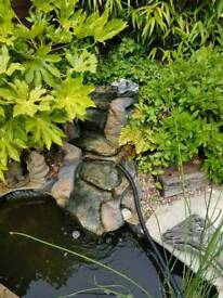 Waterfall, pump and external filter for fish pond