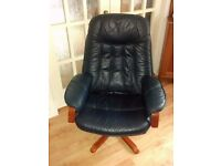 Navy blue Leather swivel recliner chair.