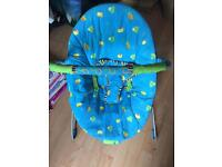 Baby bouncer with vibrator and music box