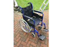 Folding manual wheelchair with hand brakes for carer and large wheels for passenger