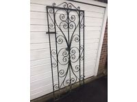 Wrought iron ornamental garden gate