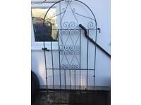 Arched Iron garden gate