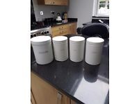 Tea, sugar, coffee and biscuit containers