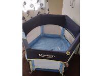 Graco round baby cot