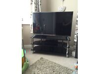 black glass tv stand with crome legs wxcellent condtion fits up to 50inch tv on it