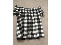 Black checkered off the shoulder top.