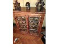 Wooden cupboard with brass elephant detail