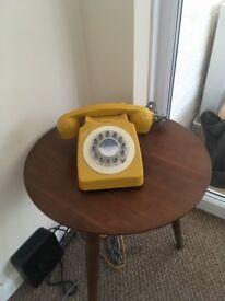Mustard yellow retro telephone