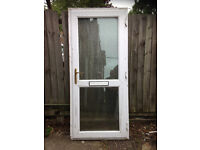 White UPVC door with glazing top and bottom that is obscure