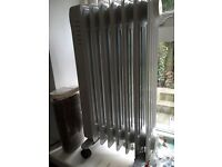 Electric heater. Nearly new. Variable heat, timer.