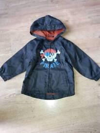 Boys Navy lightweight Rain Coat. Size 2-3 yrs.