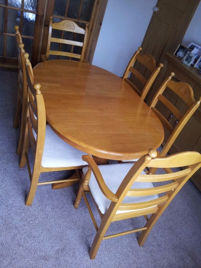 "Dining Table (Extendable6 Chairs (including 2 CarversHoney Pinein Leicester, LeicestershireGumtree - Dining Table (Extendable) & 6 Chairs (including 2 Carvers) – Honey Pine Excellent unmarked condition, as new. Cream Seat Covers Dimensions Table W 1000mm (39""), L 1500mm (59"") Retracted, L 1950mm (77"") Extended, H 720 (28"") Dimensions..."